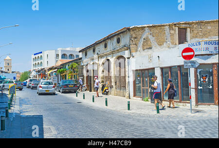 The old town is full of tiny medieval houses with cafes and shops, Larnaca, Cyprus - Stock Photo