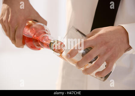 Barkeepers, detail, hands, glass, Aperol, fill, - Stock Photo