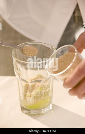 Barkeepers, detail, hands, cocktail, Caipirinha, prepare, glass, limes, sugar, fill, close up, - Stock Photo