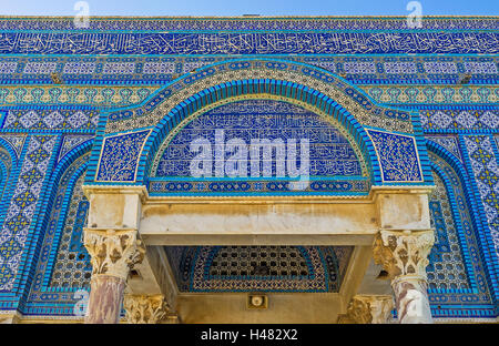 The entrance canopy of the Dome of the Rock decorated with the old arabic calligraphy and patterns on glazed tiles, - Stock Photo