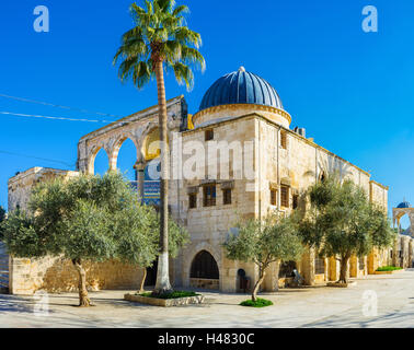 Nowadays the Temple Mount is a large architectural complex of Islamic buildings and shady gardens, Jerusalem, Israel. - Stock Photo