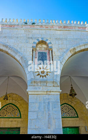 The arcade of Al-Aqsa Mosque decorated with the carved stone elements, patterns and inscriptions from Quran, Jerusalem, - Stock Photo