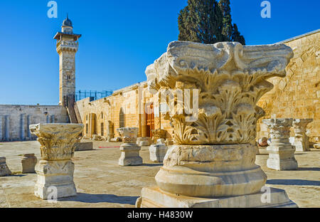 The carved stone column capital with the Al-Fakhariyya Minaret of Al-Aqsa Mosque on the background, Jerusalem, Israel. - Stock Photo