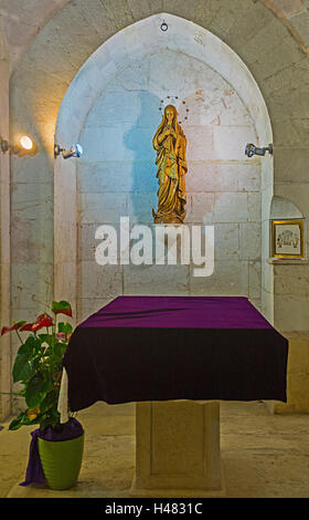 The altar of the Virgin Mary in grotto of St Anne Church - Stock Photo