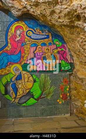 The painted icon in grotto of St Anne Church - Stock Photo