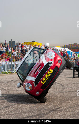 The Russ Swift Mini Display Team performing Skiing, an automotive driving stunt where the car is driven while balanced - Stock Photo
