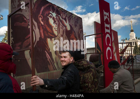 Workers install soviet placards at central avenue of the VDNKh the All-Russia Exhibition Centre in Moscow, Russia - Stock Photo
