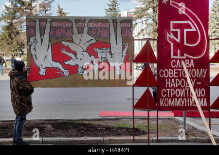 A man holds posters of the Soviet era in the VDNKh All-Russia exhibition in Moscow, Russia - Stock Photo