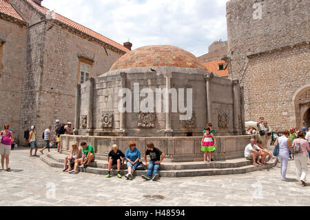 DUBROVNIK, CROATIA - JUNE 28, 2010: Unidentified tourists near the Big Fountain of Onofrio, one of the old town - Stock Photo