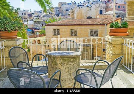 The cozy terrace of the Austrian Hospice with the panoramic view on the old housing of the Muslim Quarter of Jerusalem, - Stock Photo