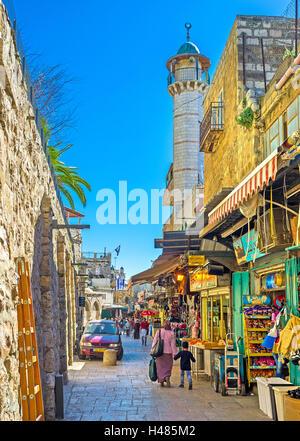 The white minaret rises over the bazaar in Muslim Quarter, next to Damascus Gate, Jerusalem Israel - Stock Photo