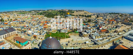 The panoramic view on the old city with the Dome of the Rock and the Mount of Olives on the background, Jerusalem, - Stock Photo