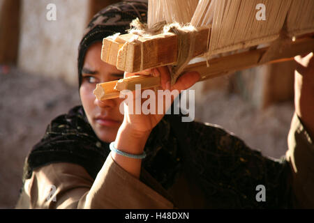 Egypt, Hurghada, woman, young, loom, seriously, work, portrait, - Stock Photo