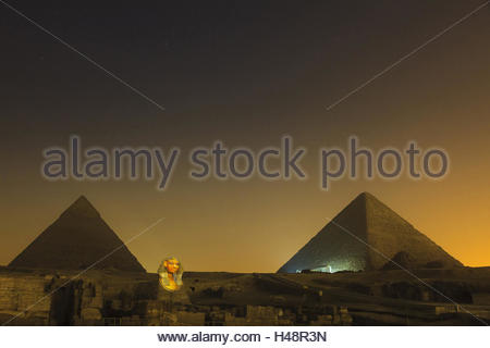 During a light show illuminateded Chephren pyramid and sphinx, sound and Light show, Egypt, Cairo, Gizeh, - Stock Photo