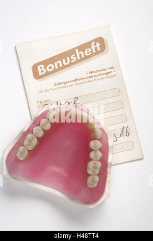 Bonus notebook, denture, cog care, cog precaution, precaution, set dentures, bite, prosthesis, full prosthesis, - Stock Photo