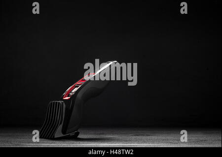 Hair trimmer in front of a black background - Stock Photo