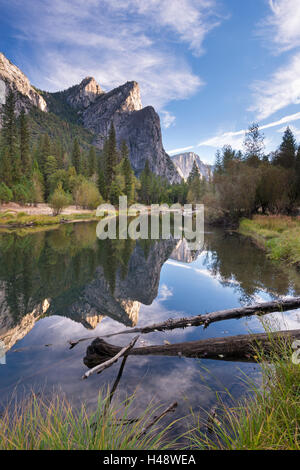 The Three Brothers mountains reflected in the tranquil waters of the River Merced, Yosemite National Park, California, - Stock Photo
