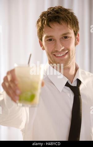 Barkeepers, smile, hold cocktail, Caipirinha, portrait, - Stock Photo