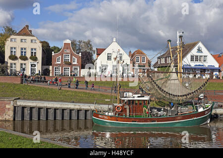 autumn mood, shrimp boat in the harbour of Greetsiel (village), - Stock Photo