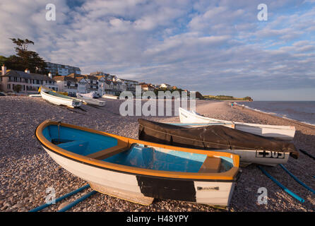 Boats pulled up onto the beach at Budleigh Salterton, Devon, England. Summer (July) 2014. - Stock Photo