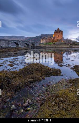 Eilean Donan Castle at twilight, Dornie, Scotland. - Stock Photo