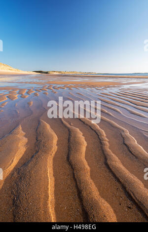 Sand patterns on Embleton Beach at low tide, Northumberland, England. Spring (May) 2013. - Stock Photo