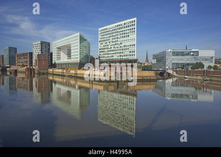 Germany, Hamburg, construction of the new Spiegel publishing house on the Ericusspitze reflecting in the water of - Stock Photo
