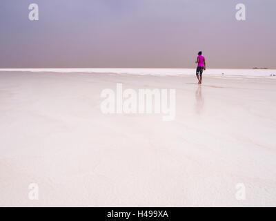 Tourist visiting salt desert and lake in the Afar Region, Danakil Depression, Ethiopia. - Stock Photo