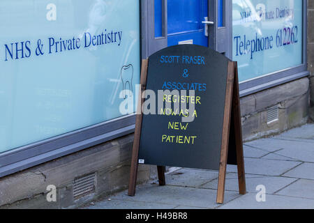 Scott Fraser & Associate Dental Surgery NHS is a Private Dental Surgery located at 48 High St Lochee in Dundee, - Stock Photo