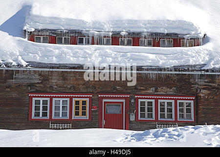 Wooden house, snow, icicle, - Stock Photo