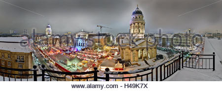 Germany, Berlin, Christmas magic at Gendarmenmarkt, Christmas fair, white Christmas in Berlin, above the roofs of - Stock Photo