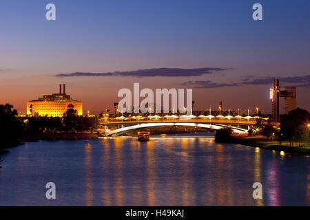 Spain, Andalusia, Seville, Pasarela de la Cartuja, evening, bridge, tourboat, - Stock Photo