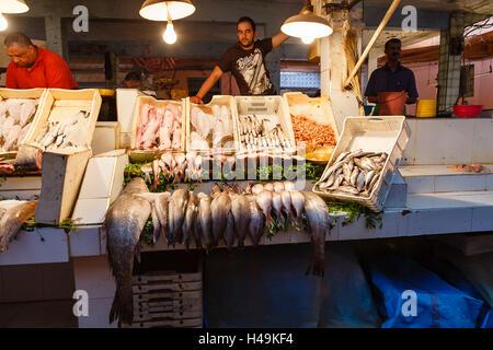 Fish seller on fish souk at Jamaa el Fna, Marrakesh, Morocco - Stock Photo