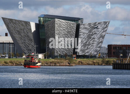 The Titanic Building  in Belfast's Titanic Quarter.In the foreground is the 'Mona', a boat used for Titanic Boat - Stock Photo