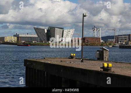 View across the Port of Belfast to The Titanic Building  in Belfast's Titanic Quarter. - Stock Photo