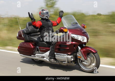 Motorcyclist, Honda Goldwing, red, travel motorcycle, sports motorcycle, - Stock Photo