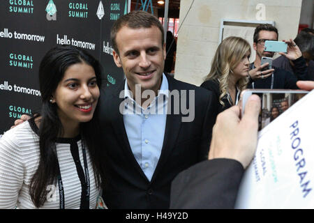 Paris, France. 14th October, 2016. Emmanuel Macron stikes a pose for a photo with a young woman at Hello Tomorrow - Stock Photo