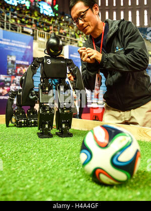 Changchun, China's Jilin Province. 15th Oct, 2016. A technician debugs a soccer robot at the Cospace Robot Contest - Stock Photo
