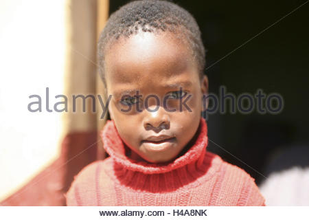 Africa, South Africa, eastern cape, game Coast, Transkei, child before traditional round steelworks, portrait, - Stock Photo