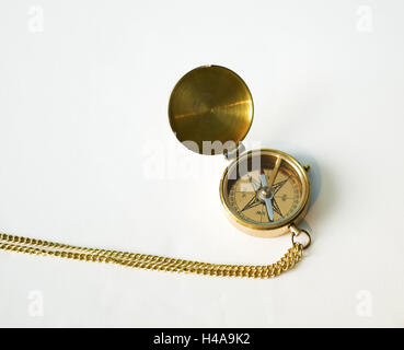 Compass, golden-coloured, opened, directions, the east, the south, the west, the north, orientation, guidance, geography, - Stock Photo