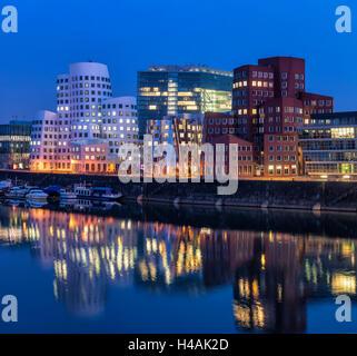 Düsseldorf, North Rhine-Westphalia, Germany, Gehry houses and Neuer Zollhof at dusk - Stock Photo