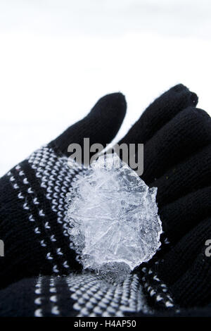 ice in the hand, gloves, Norwegian pattern, - Stock Photo