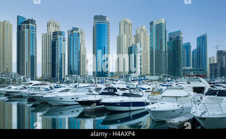 Yachts in the harbour of Dubai Marina, high rises, Dubai, United Arab Emirates - Stock Photo