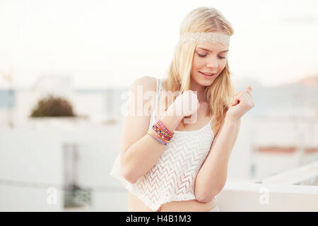 young woman in summer clothes on roof terrace - Stock Photo