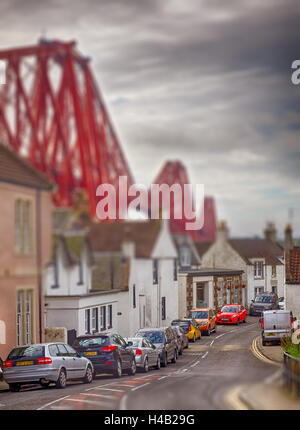 Edinburgh, Scotland -  01 September 2016 : Homes under the Forth Rail Bridge connecting the towns of North and South - Stock Photo