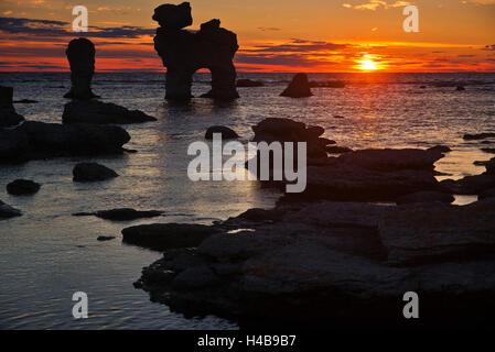 stacks on the Island Farö close Gotland, Sweden, silhouette, sundown, - Stock Photo