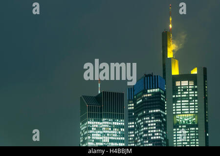 Germany, Hesse, Frankfurt, Commerzbank, TaunusTurm and Euro Tower at dusk - Stock Photo