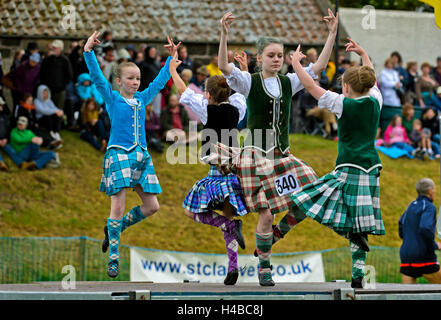 Girls dancing in kilts at the Ceres Highland Games folk dance competition, Ceres, Scotland, United Kingdom - Stock Photo