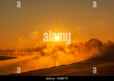Fog at the Elbe river near Torgau during a winter sunrise - Stock Photo