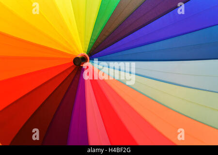 Bright umbrella with rainbow colors close--up - Stock Photo